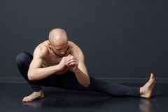 Man is doing lunge aside, squat stock photography