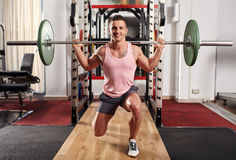 Man doing lunges with barbell stock photo