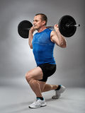 Man doing lunges, legs workout Stock Images