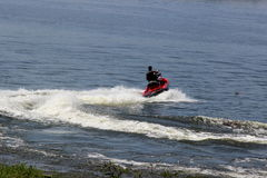 Man doing maneuvers radicals jetski on lake Royalty Free Stock Photos