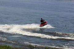 Man doing maneuvers radicals jetski on lake Royalty Free Stock Photos