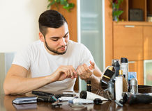 Man doing manicure at home Stock Photography