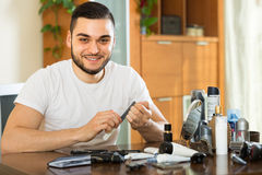 Man doing manicure at home Royalty Free Stock Photos
