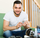 Man doing manicure at home Royalty Free Stock Image