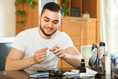 Man doing manicure at home Royalty Free Stock Photography