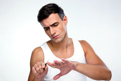 Man doing manicure Stock Images