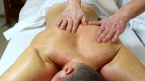 Man doing massage stock video footage