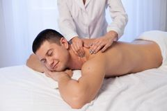 Man doing medical massage and body treatments at the Spa royalty free stock photos