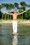Man doing meditation exercises Stock Photos