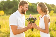 Man doing on the nature engagement girl, surprise, emotion, at s Stock Photo