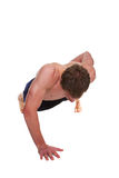 Man doing a one handed push up Stock Image