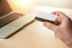 The man doing online shopping with credit card Royalty Free Stock Photography