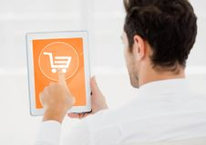 Man doing online shopping on digital tablet royalty free stock photo