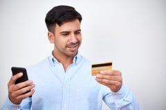 Man doing online shopping stock image