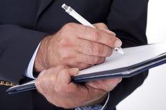 Man doing paperwork Royalty Free Stock Image