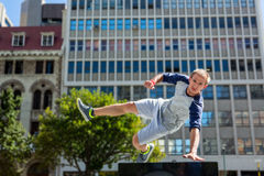 Man doing parkour in the city stock image