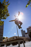Man doing parkour in the city Stock Images