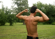 Man doing physical exercises. In a park Stock Image