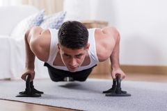 Man doing physical exercises Stock Photo