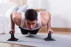 Man doing physical exercises Stock Photo