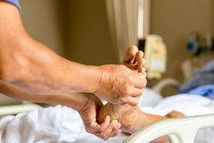Man doing physical therapist treatment patient giving a foot mas Royalty Free Stock Images