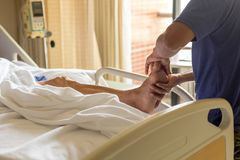 Man doing physical therapist treatment patient giving a foot mas. Sage in a hospital Stock Photos