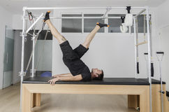 Man doing pilates in cadillac. Royalty Free Stock Image