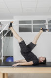 Man doing pilates in cadillac. Stock Photo