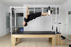 Man doing pilates in cadillac. Stock Photography