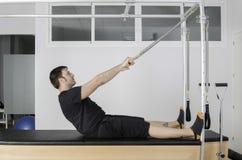 Man doing pilates in cadillac. Royalty Free Stock Photo