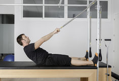 Man doing pilates in cadillac. stock image