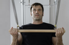 Man doing pilates in cadillac. Stock Photo