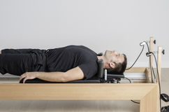 Man doing pilates in cadillac. Royalty Free Stock Images