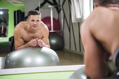 Man doing pilates exercises stock image