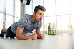 Man doing planking exercise in gym. Portrait of a fitness man doing planking exercise in gym royalty free stock images