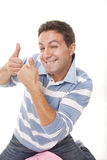 Man doing positive sign. Closeup of a happy young male showing thumbs up sign Royalty Free Stock Photos