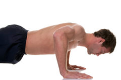 Man doing a press up isolated Royalty Free Stock Images