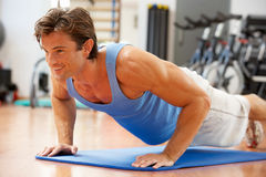 Man Doing Press Ups Stock Photo