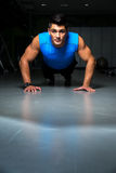 Man Doing Press Ups In Gym Royalty Free Stock Photos