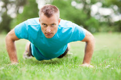 Man doing press ups outdoors Royalty Free Stock Photo