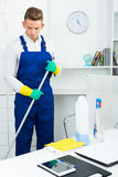 Man Doing Professional Clean-up Stock Photography
