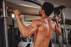 Man doing pull ups on the bar Stock Photography