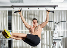 Man doing pull-ups Stock Photo