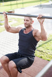 Man doing pull-ups on horizontal bar outdoor Royalty Free Stock Photo