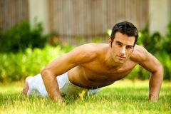 Man Doing Push Up. An attractive caucasian man doing a push up outdoors Royalty Free Stock Photography