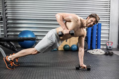 Man doing push up with dumbells Royalty Free Stock Photos