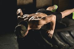Push up exercise on tire fitness training Royalty Free Stock Images