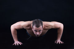 Man doing push ups Stock Image