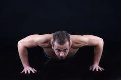 Man doing push ups Stock Image