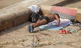 Man doing push ups, beach, Lebanon Stock Photo
